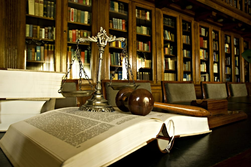 scales of justice, gavel on a law book